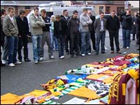 Motherwell players looking at the tributes