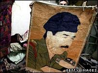 Rug with Saddam Hussein's portrait