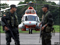 A Colombian policeman guards a Venezuelan helicopter in Villavicencio on 29 December 2007