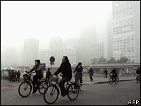 Cyclists on a smog-filled Beijing street in October 2007