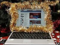 A laptop wrapped in tinsel