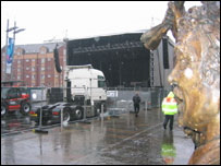 A statue keeps an eye on preparations for the New Year's Eve gig
