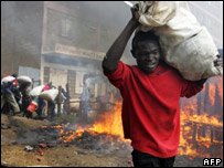 A Kenyan man carrying a sack