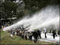 Demonstrators in Kibera, Nairobi, are hosed by water cannon