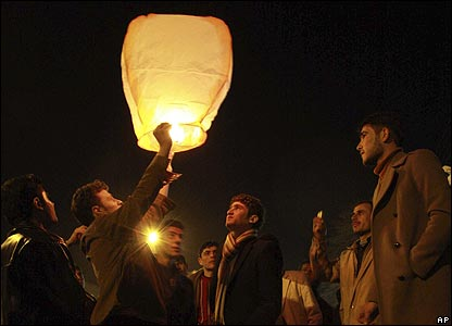 Iraqi Kurds launch a fire lantern to celebrate the New Year in Sulaimaniya, 260km (160 miles) northeast of Baghdad, Iraq