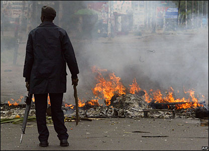A policeman stands in front of a barricade in Nairobi