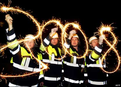 German fire-fighters welcomed in the new year with sparklers in Munich.