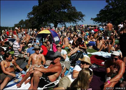 Sydney residents arrive at Mrs Macquaries Point to view the annual New Year's Eve Sydney Harbour fireworks display.