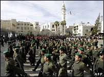 Palestinian security forces attend a parade marking the 43rd anniversary of the Fatah movement in the West Bank town of Bethlehem