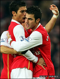Eduardo and Cesc Fabregas celebrate after putting Arsenal ahead
