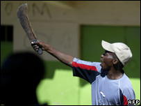 A man gestures during clashes between rival groups in Nairobi's Mathare slum, 1 January 2008