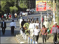 Kenyans travel by foot amid curbs on traffic in the capital Nairobi on Wednesday 2 January 2008
