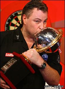 John Part kisses the World Championship trophy