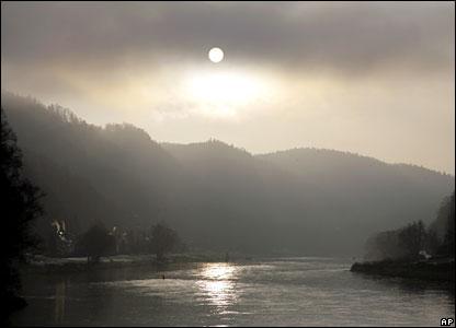 The sun rises above the river Elbe near Bad Schandau, eastern Germany