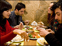 Haluk sharing lunch with friends