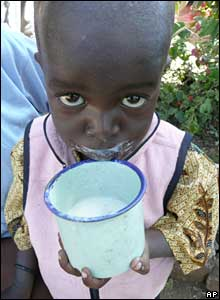 A Luo child drinks milk at a shelter at a police station in Mwiki