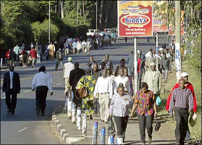 People walk into Nairobi as transport remains limited