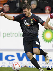 Caley Thistle's Marius Niculae takes possession at Pittodrie