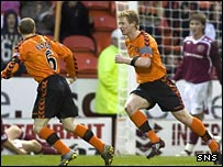Barry Robson (right) wheels away in celebration after opening the scoring for Dundee United