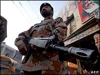 A paramilitary soldier stands guard in Ms Bhutto's home town of Larkana