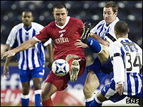 Michael Higdon holds off the challenge of Kilmarnock's Frazer Wright