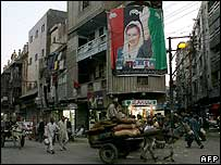 A poster of the late Benazir Bhutto hangs from a building in Karachi