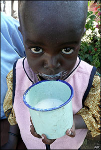 A Luo child drinks milk in Mwiki, Kenya, on 2 January