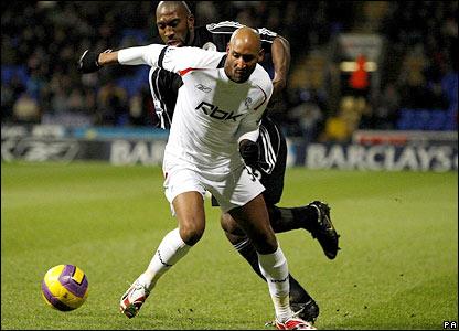 Bolton striker Nicolas Anelka holds up the ball
