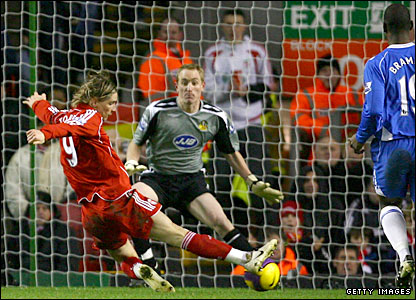 Fernando Torres scores from close range to put Liverpool ahead