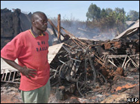Man at scene of smouldering remains of Assemblies of God Church in Eldoret