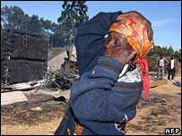 Woman weeps outside the Assemblies of God Church in Eldoret