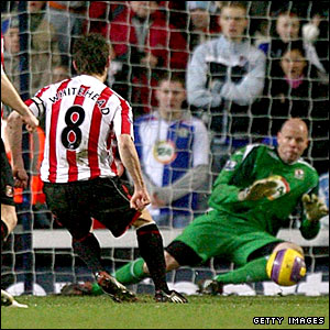 Dean Whitehead's penalty is saved by Brad Friedel
