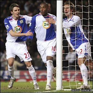 Benni McCarthy celebrates scoring from the penalty box for Blackburn