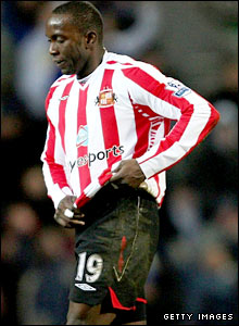Dwight Yorke trudges off after his red card