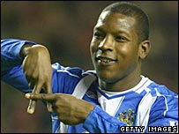 Titus Bramble celebrates scoring for Wigan