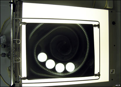 Four golf balls show clearly on an X-Ray