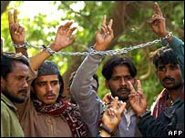 Men detained on suspicion of rioting arrive at court in Karachi, 2 January 2008