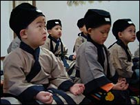 Children in traditional costume in the classroom