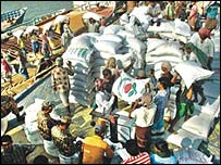 Rice being loaded onto a Bangladeshi boat