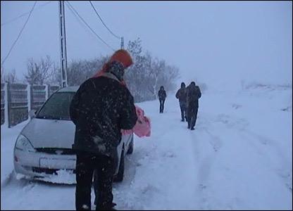 Snow-bound road in southwestern Romania