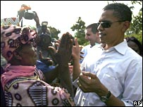 Barack Obama greets his grandmother, Sarah Hussein Obama, at his father's house in western Kenya in August 2006