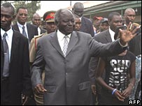 Kenyan President Mwai Kibaki (C) votes last week