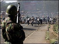 Demonstrators running from police in Nairobi 3/1/08