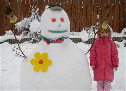 Big snowman with a little girl