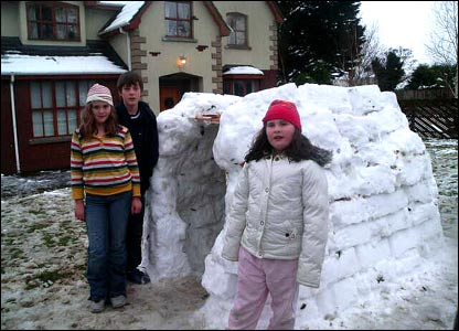Children with homemade igloo