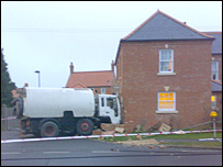 Roadsweeper and house