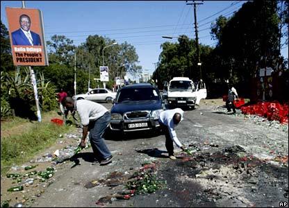 Kiosk owners clear road of debris in Nairobi