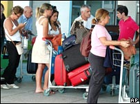 Tourists queue at Mombasa's international airport on Friday 4 January