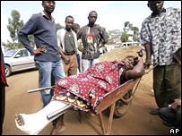 On Friday 4 January, relatives transport a woman who broke her leg during the violence in Nairobi
