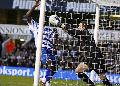 Paul Robinson is unable to keep the ball out